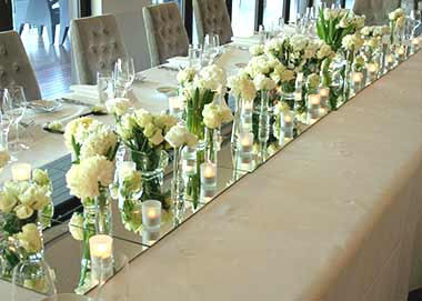 white-candle-flower-wedding-centrepieces