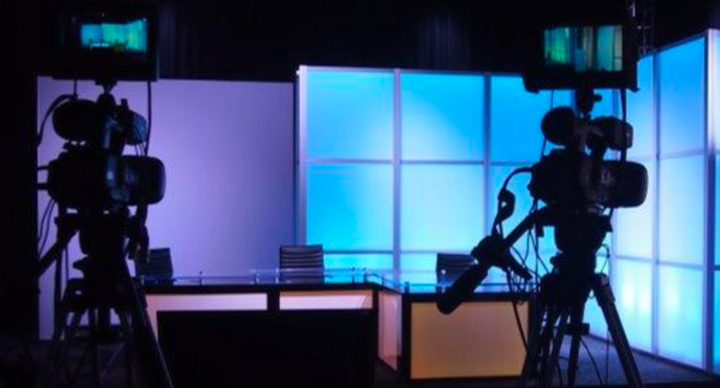 Professional cameras face an empty broadcast studio stage