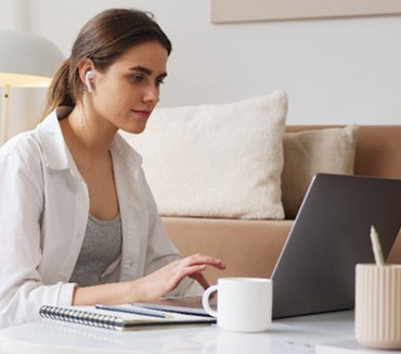 Female virtual event attendee at home on her laptop